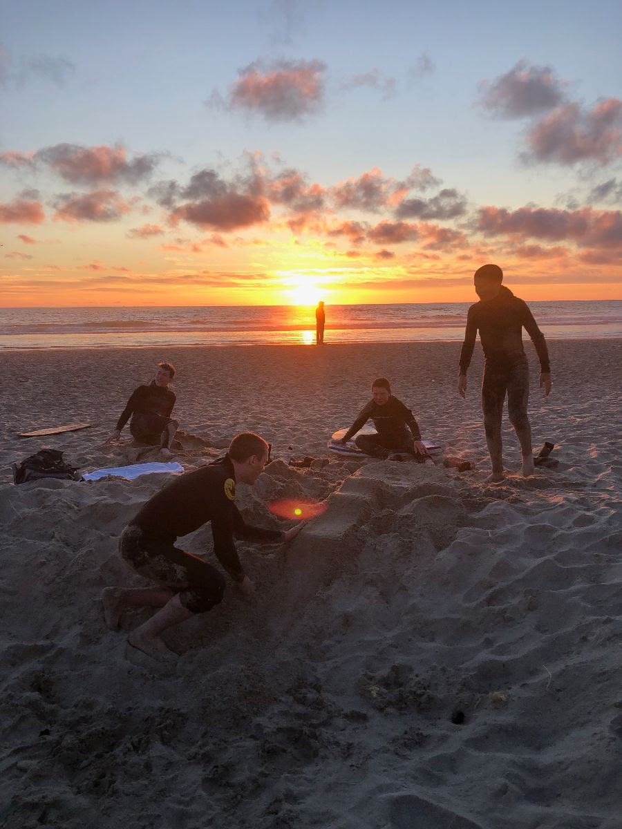 The students enjoying a beautiful Pacific Ocean Sun set