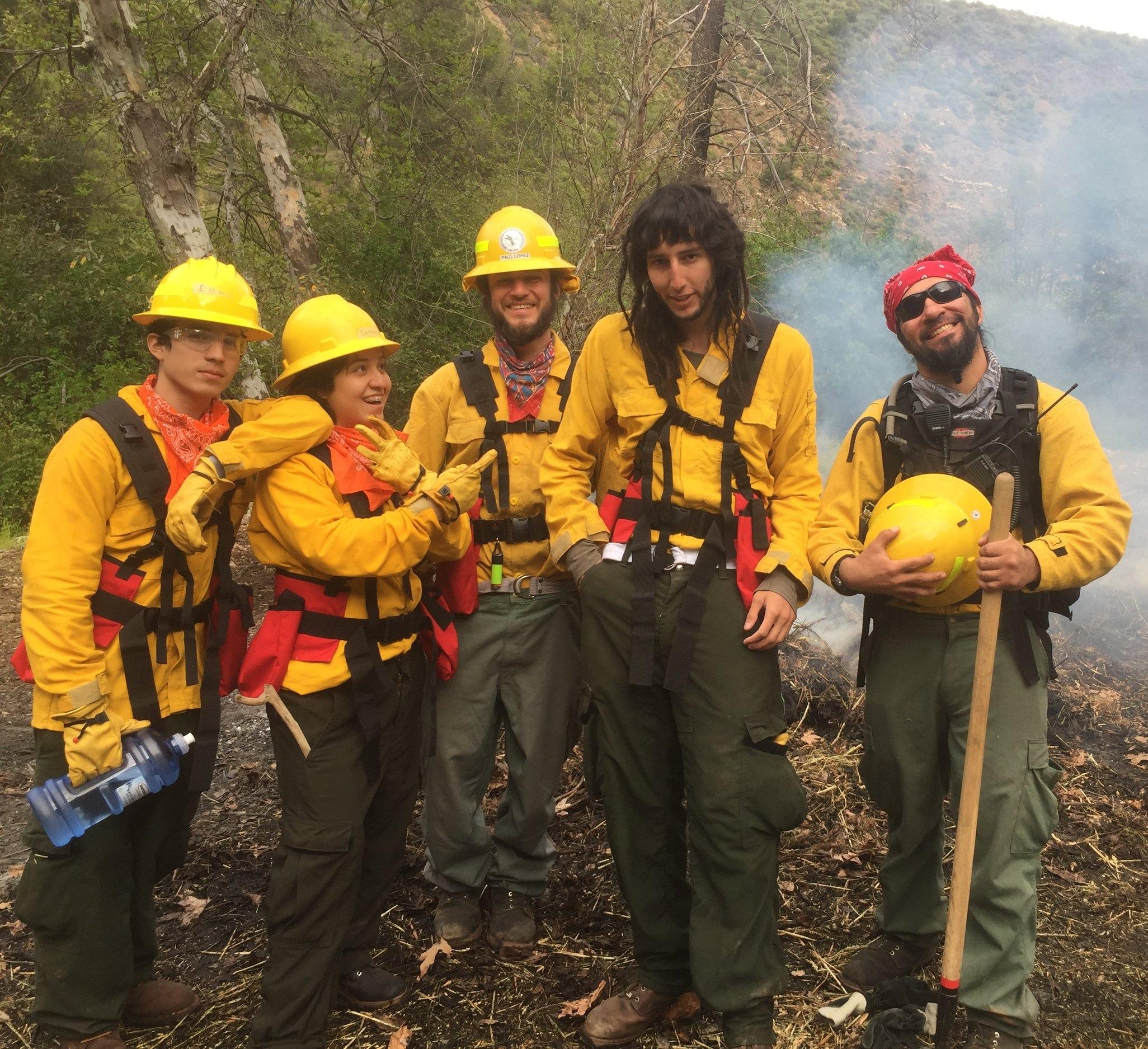 AMLT Native Stewards extinguishing a burn pile.
