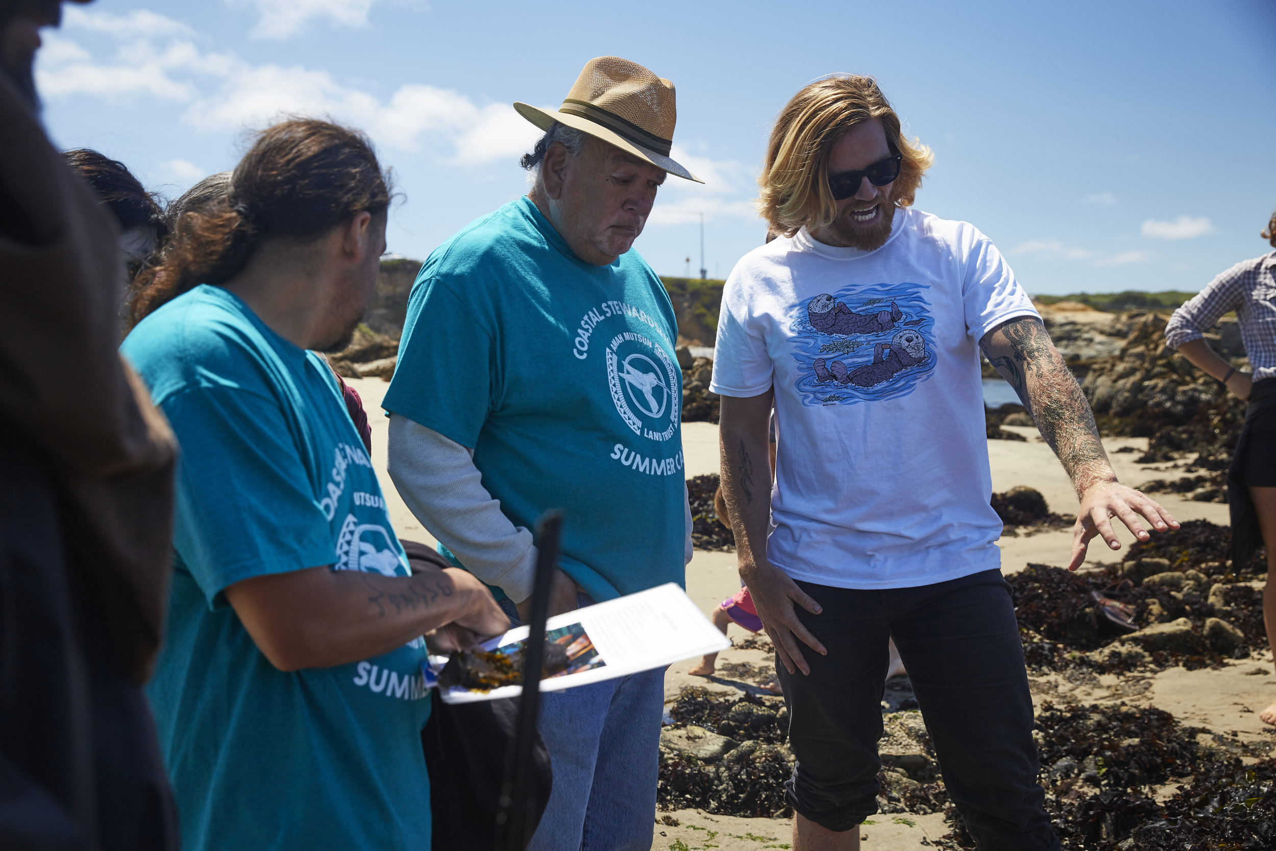 Gabriel Pineida, Val Lopez, and Mike Grone (Left to right) looking at mussel beds. Photo courtesy of Rob Brodman
