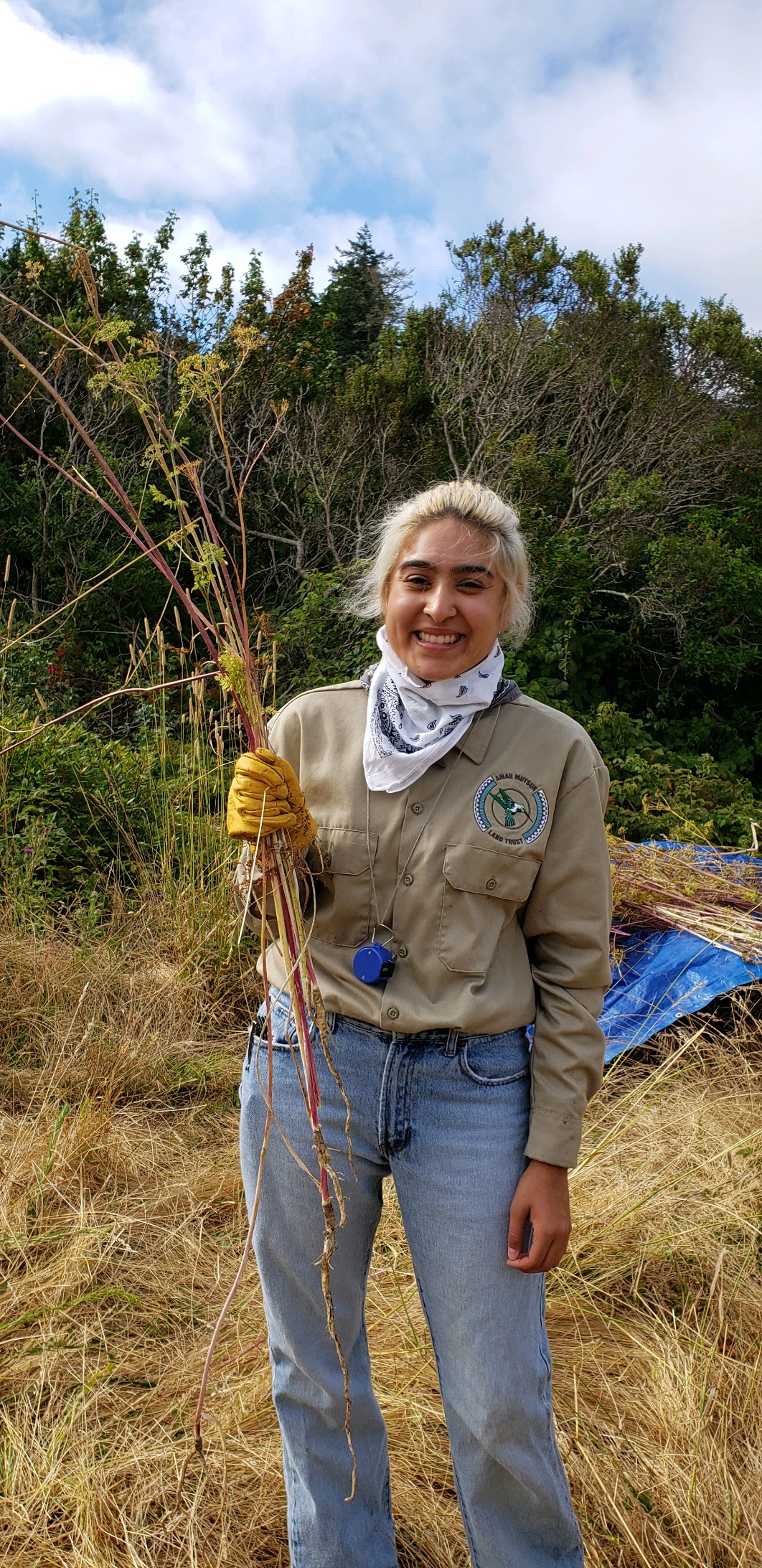 Author, Adriana Luna weeding poison hemlock in Quiroste Valley