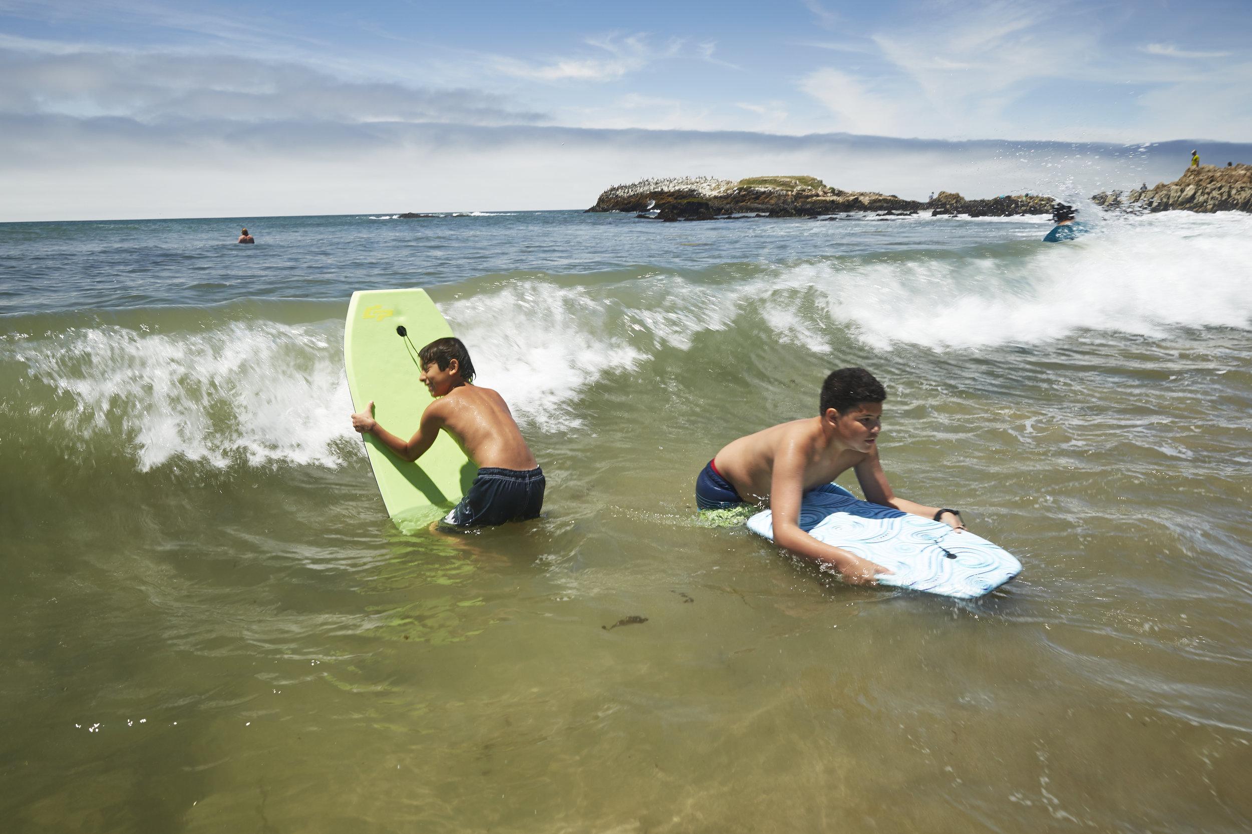 Amah Mutsun youth boogie boarding during summer camp beach day. Photo curtesy of Rob Brodman