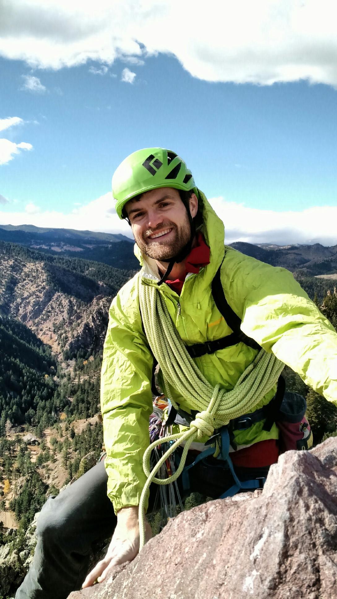 Dustin guiding at the top of the Yellow Spur in Eldorado Canyon, Colorado. Photo credit to Sarah O'Donoghue