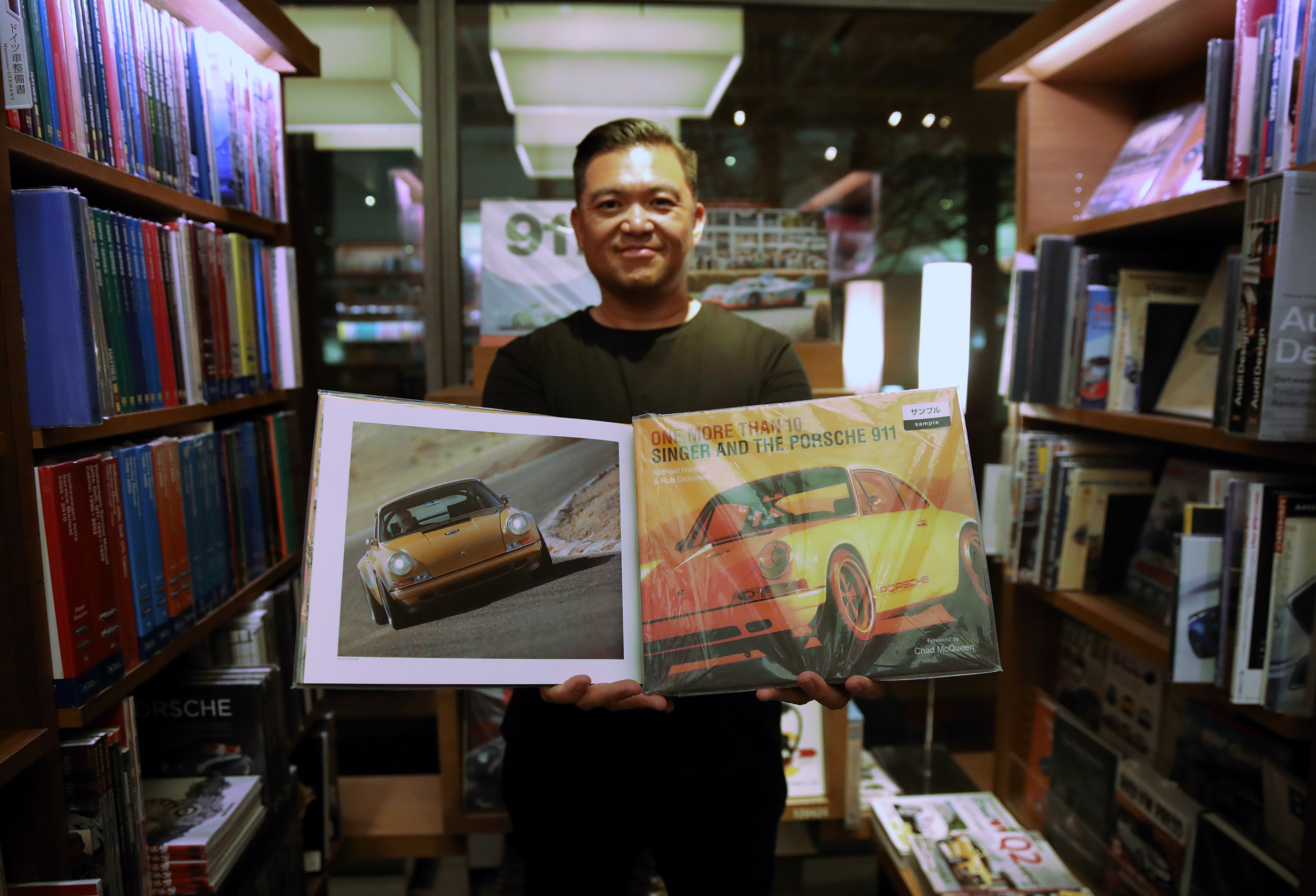 """Me at Daikanyama Tsutaya in Tokyo Japan with the hardcover book I worked on, """"One More Than 10"""" about Singer Vehicle Design and the Porsche 911."""