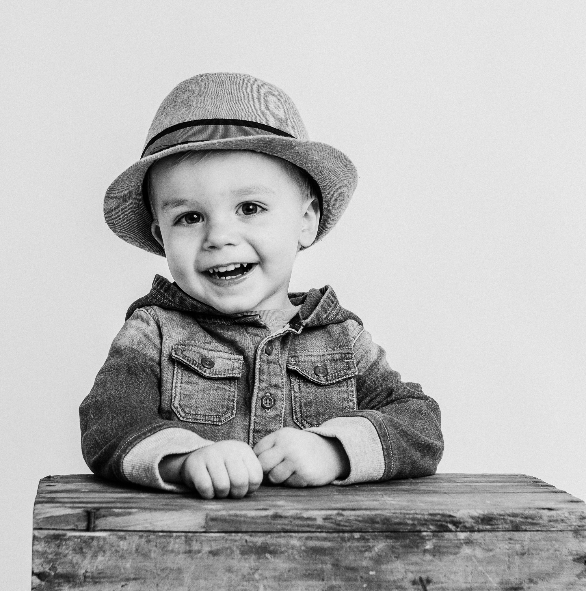 boy laughing in studio  belleville family photographer