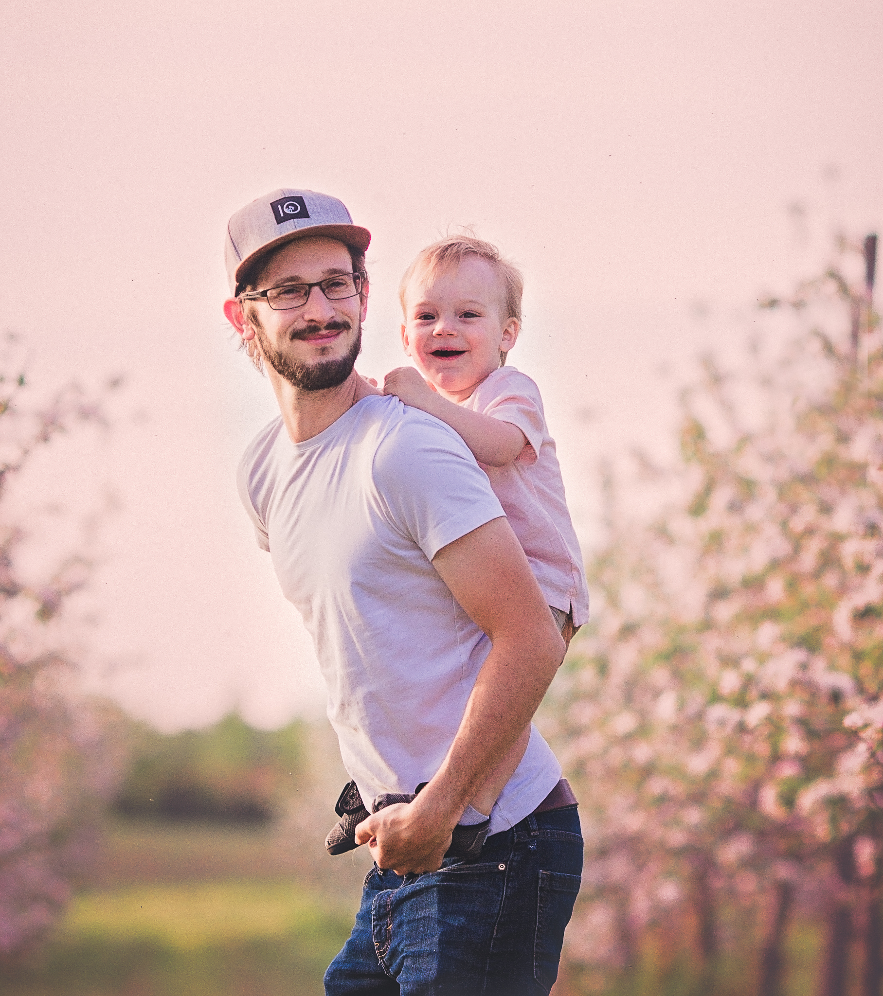 dad with son in apple orchard  belleville family photographer