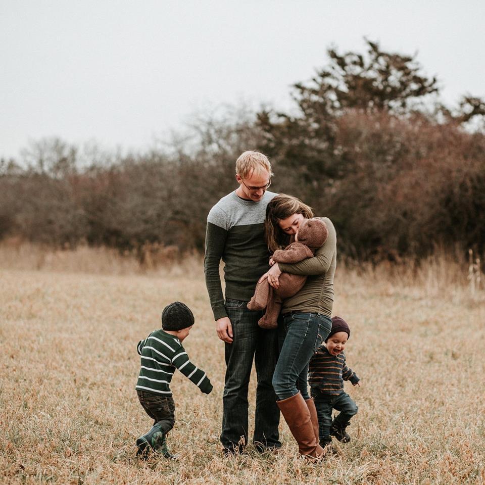 Happy family in field