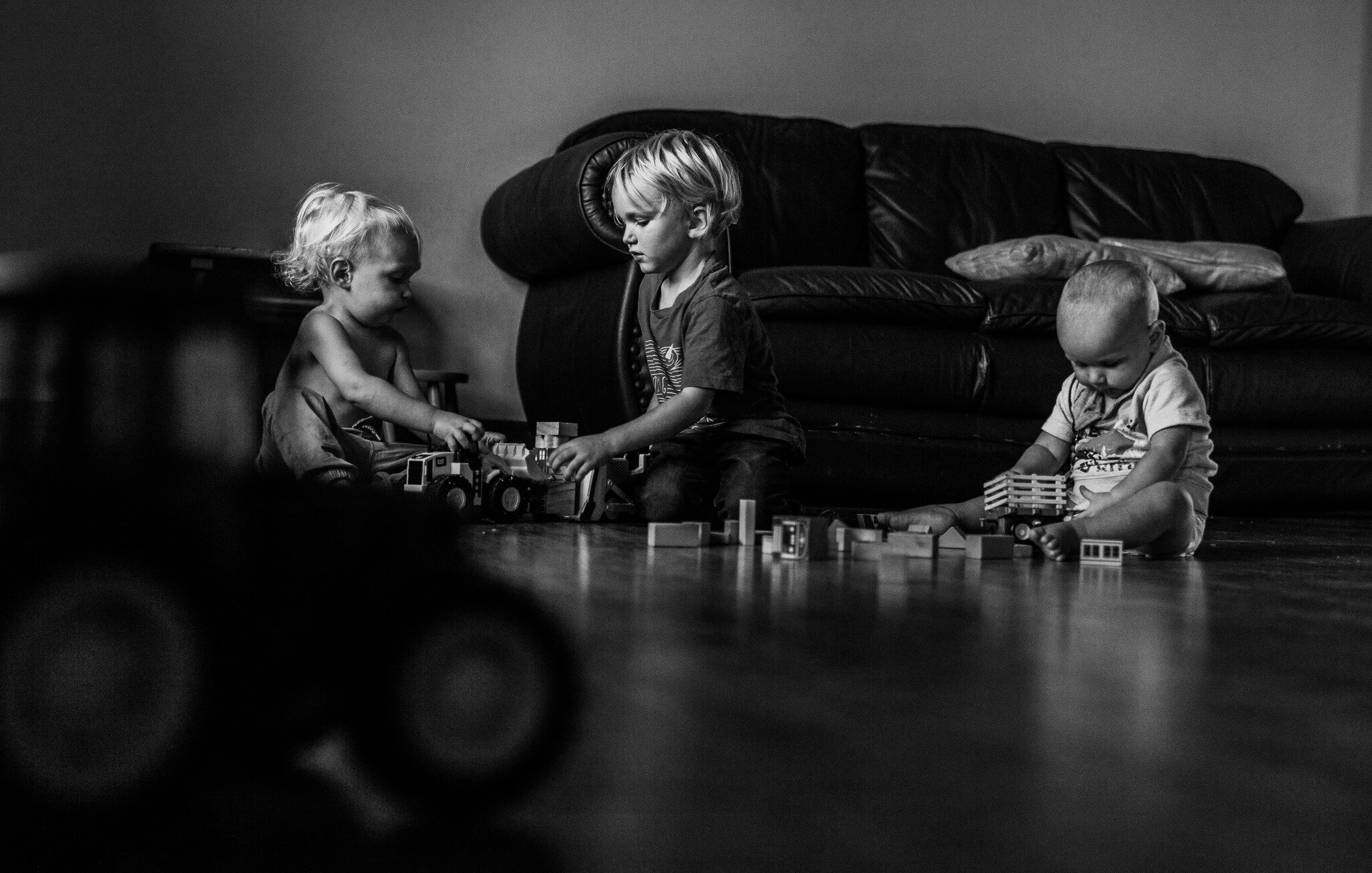boys playing with blocks and trucks