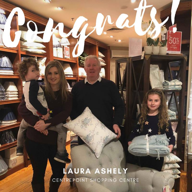 Out happy winner of the  Laura Ashley Hobart scatter cushion and throw rug has collected her prize.  Willo Mia McClay, along with Charlie and Bonnie are pictured with Centre Manager Brett McGrath.  Well done Willo.