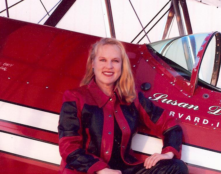"""SUSAN DACY & BIG RED   Susan will inspire young girls with her career story as one of the most accomplished female pilots in the world. When not flying her Stearman """"Big Red"""", you can find her in the cockpit of an American Airlines Boeing 777."""