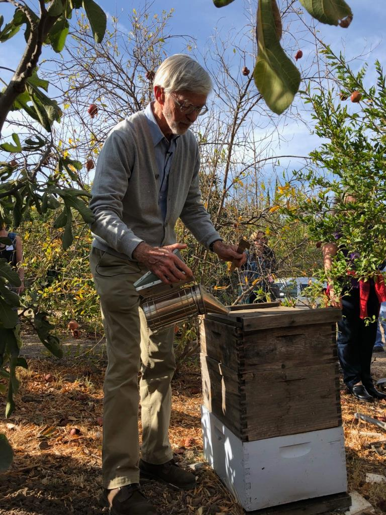 Our friend, Gunthur Hauk, getting to know our bees.