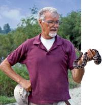 Owen Sexton, PhD, holds a fox snake at Marais Temps Clair in St. Charles County, MO.