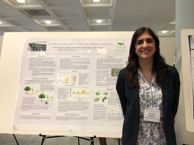 """Hanusia Higgins presenting her poster, """"The effects of oomycetes on plant-soil feedback interactions"""""""