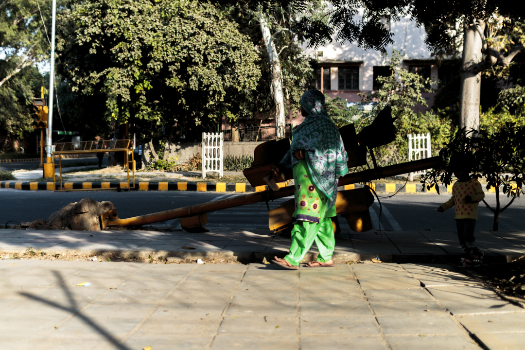 A woman walk in the street, New Delhi, India
