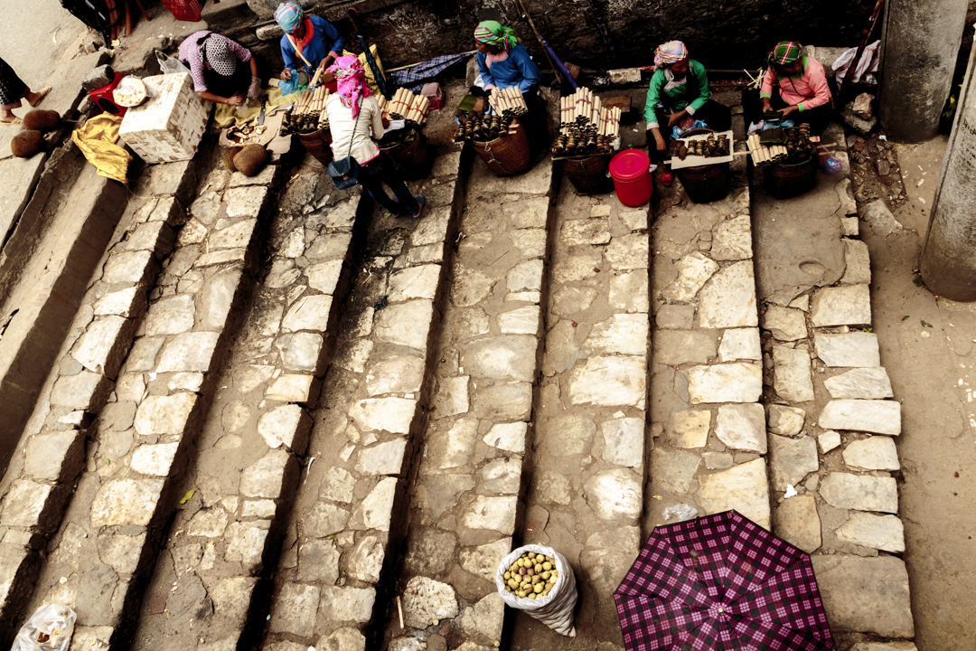 A group of women sells merchandise in the street, Sa-Pa, Vietnam