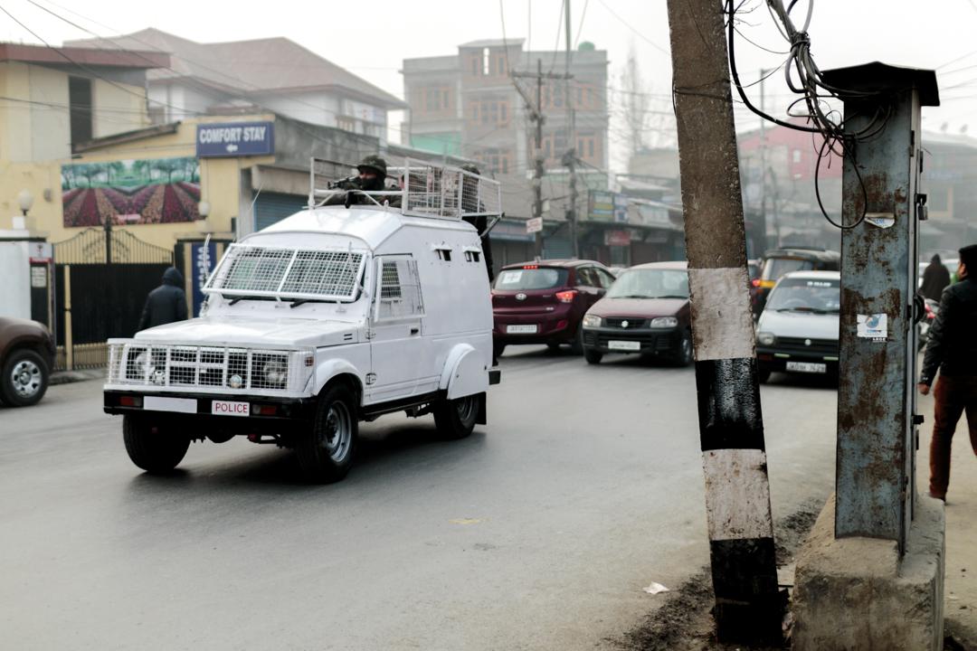 A police car patroling, Srinagar, India