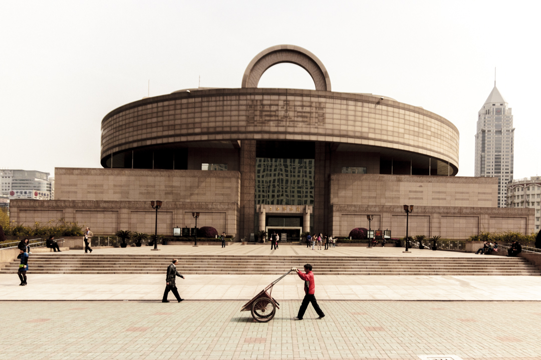 People passing by in front of an official building, Shanghai, China