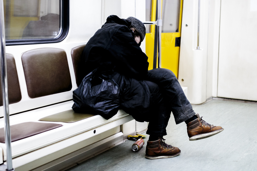 A drunk man sleeps in a subway wagon, Moscow, Russia