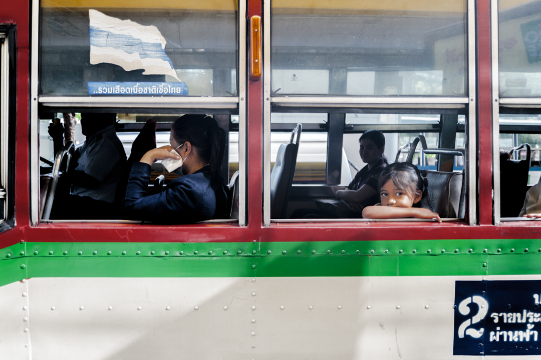 A youg girl in a bus, Bangkok, Thailand