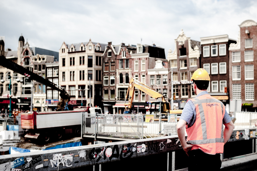 A man has a look at a construction site, Amsterdam, Netherlands