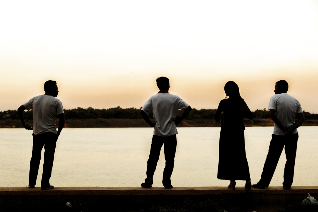 Four people watch the sunset, Kampong Cham, Cambodia
