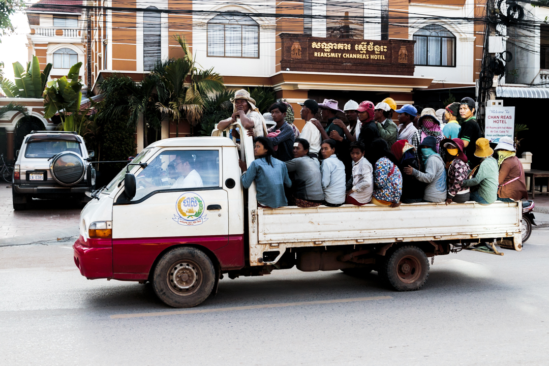 A group of people in the back of a truc, Siam Reap, Cambodia