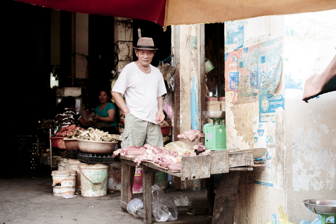 A man sells meat on the market, Kartie, Cambodia