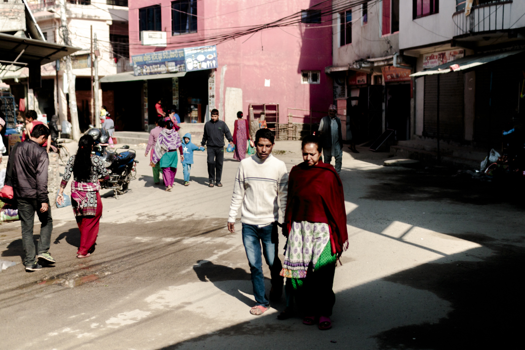 A man and a woman walks in the street, Kathmandu, Nepal