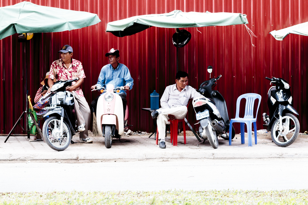 People hanging out in the street, Phnom Penh, Cambodia
