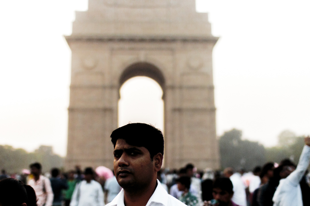 A man in front of the India Gate, New Delhi, India