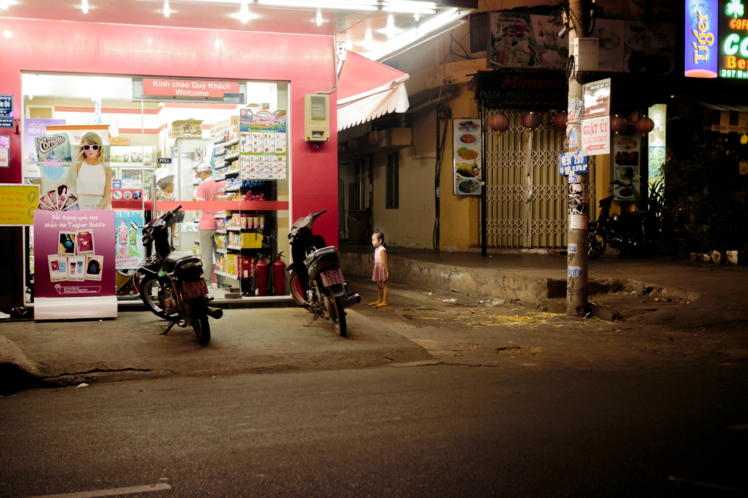 A homeless girl looks at a store, Ho chi Minh, Vietnam