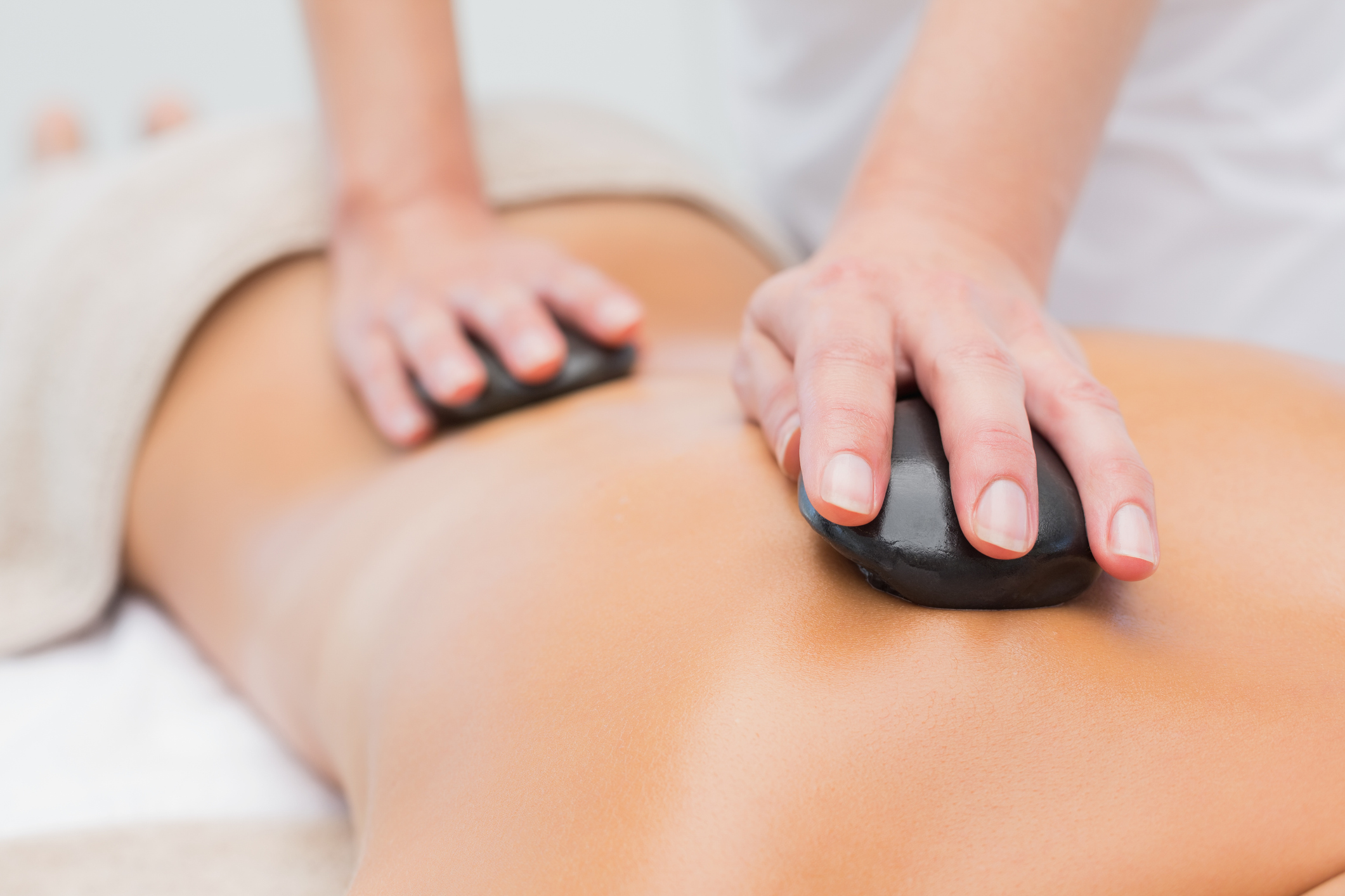 Hot Stone Massage - Perfectly smooth basalt stones are warmed in water bath . Combination of pressure and heat allows to release tension and increase circulation in deep layer of muscles