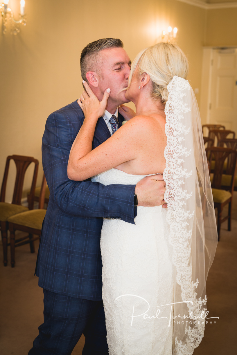 Bride and groom First Kiss at Harrogate Register Office. Wedding Photographer Yorkshire