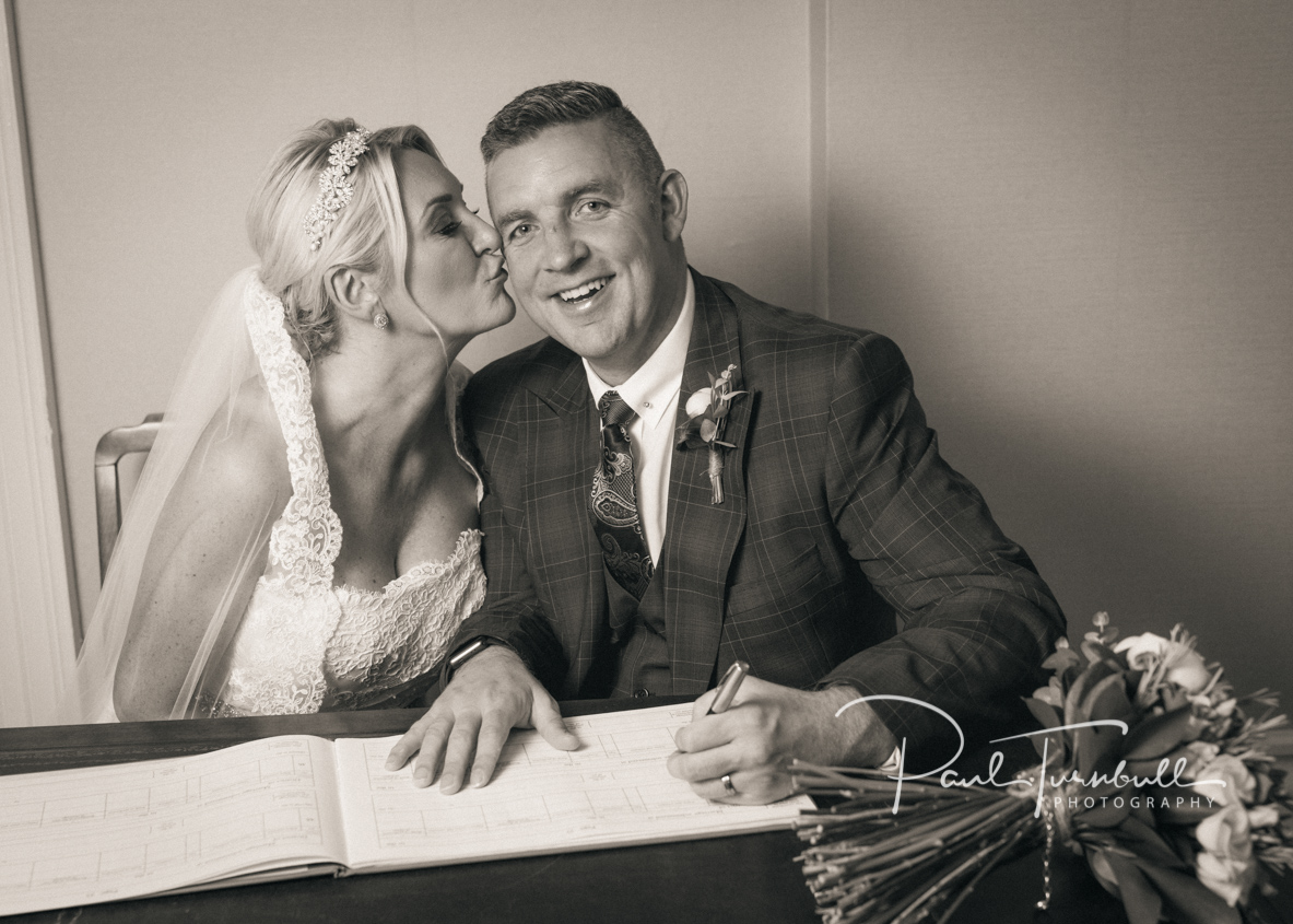 Bride and Groom Signing Register at Harrogate Register Office. Bride and groom at Harrogate Register Office. Wedding Photographer Yorkshire