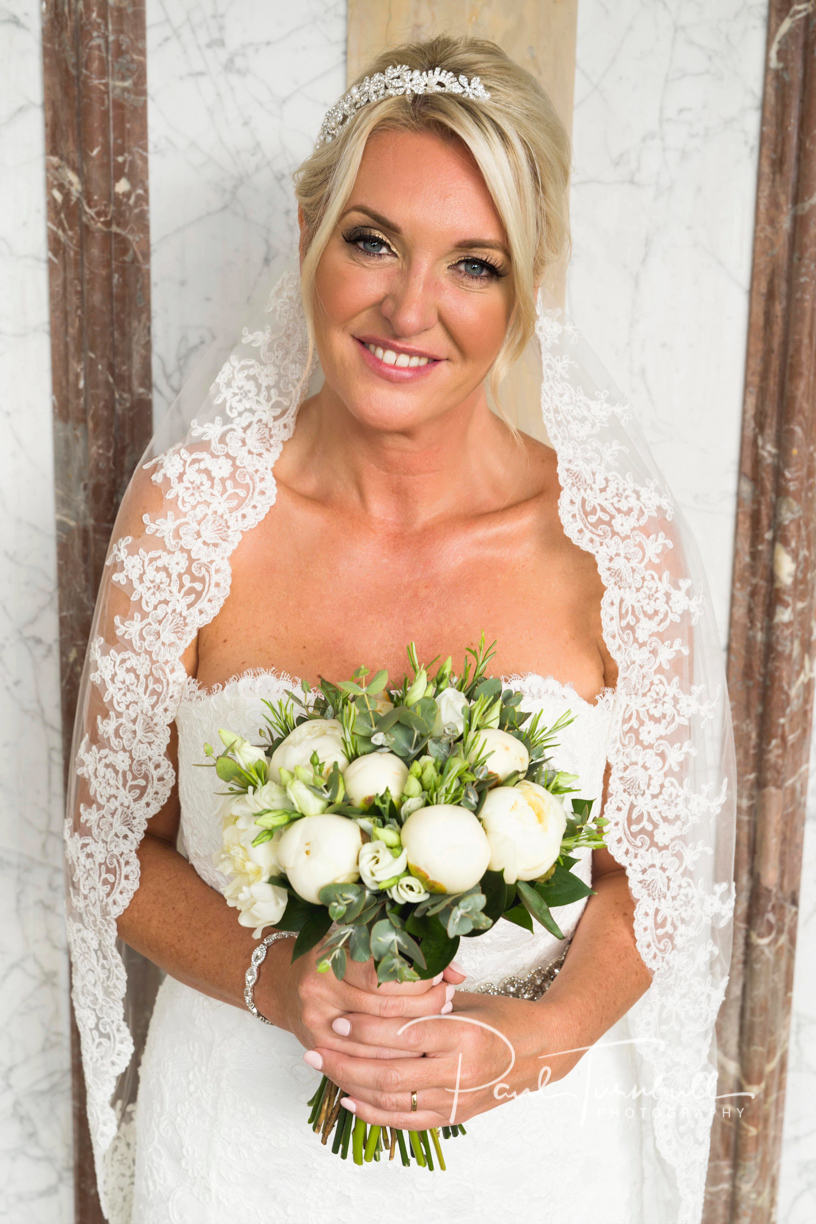 Bride Posing with Flowers at Harrogate Register Office. Wedding Photographer Yorkshire