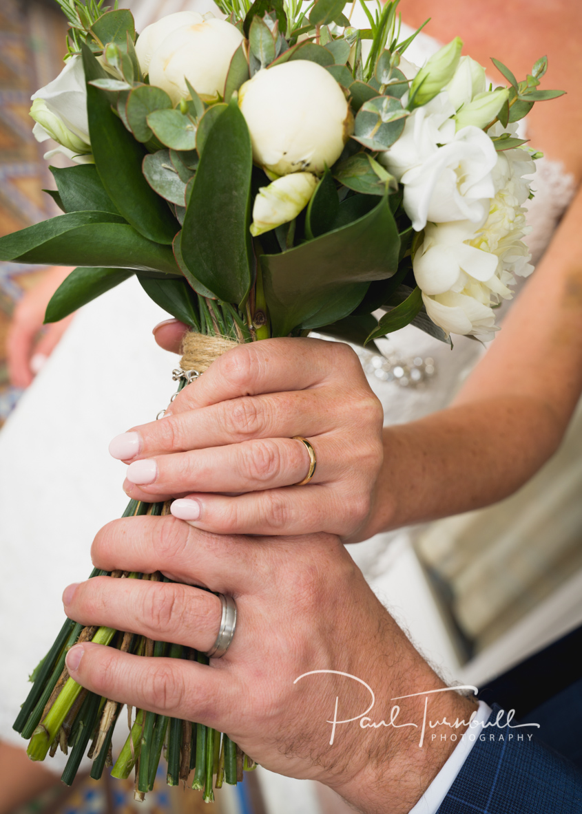 Bride and Groom with Flowers and Wedding Rings at Harrogate Register Office. Wedding Photographer Yorkshire