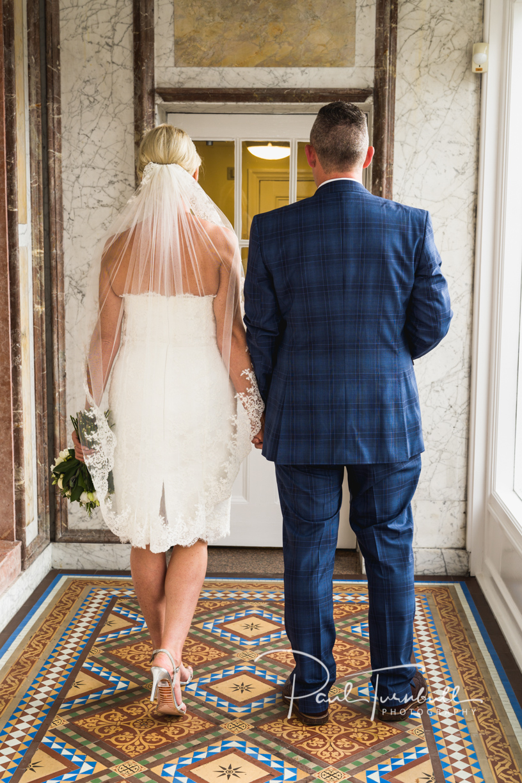Bride and Groom Prepare to Leave Harrogate Register Office. Wedding Photographer Yorkshire
