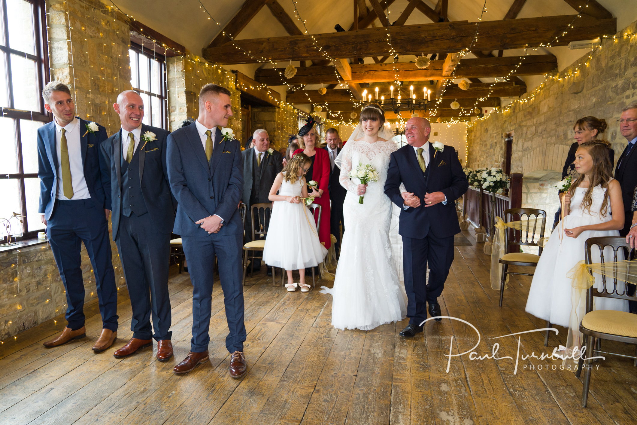 Groom sees bride for first time at Raven Hall wedding