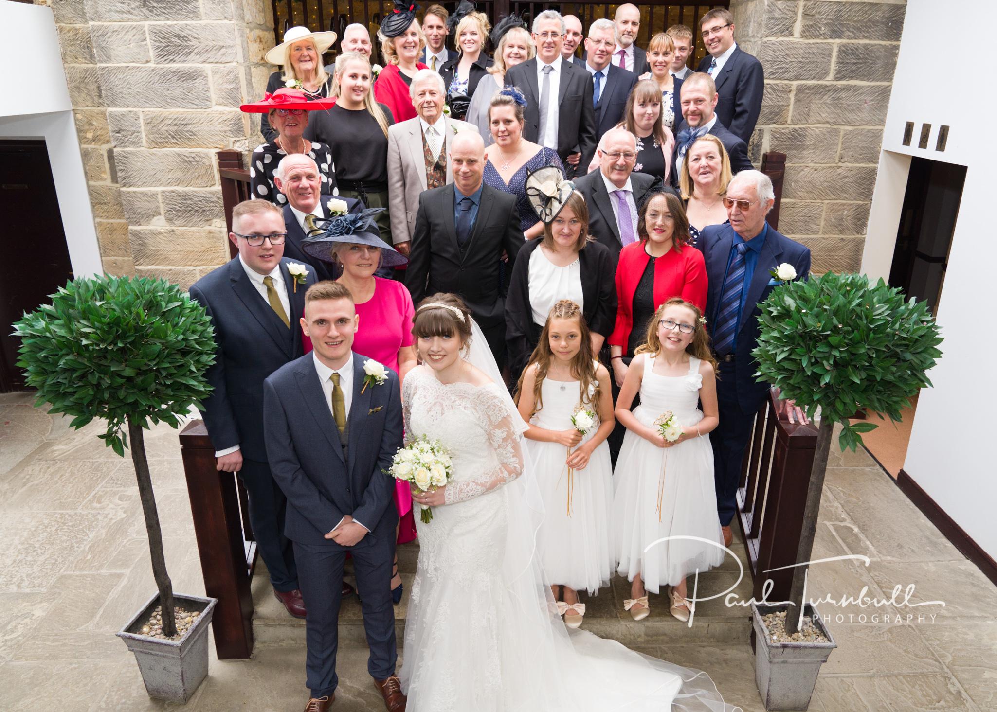 Full wedding group shot at Raven Hall, Ravenscar