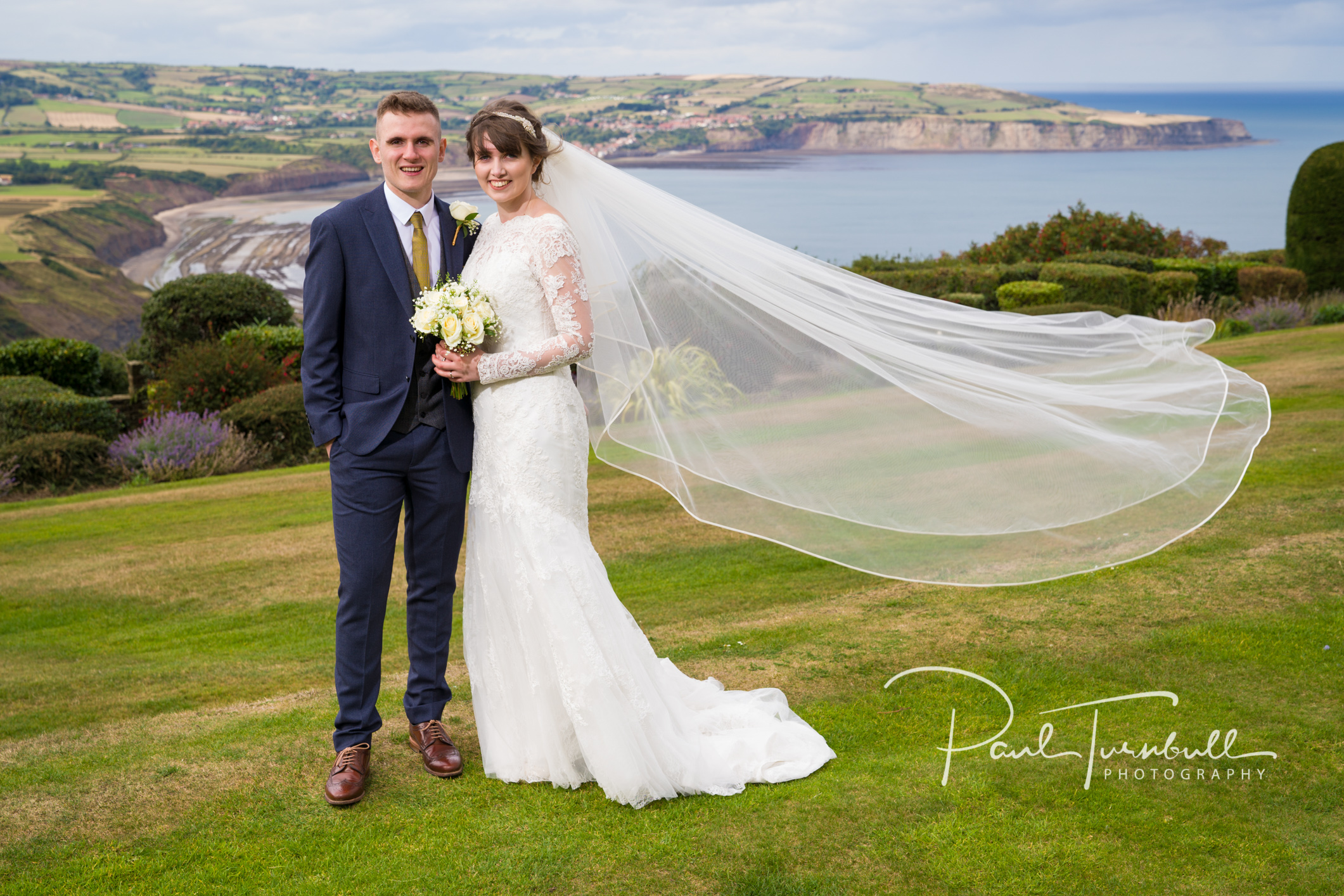 Bride and Groom enjoying the view from Raven Hall, Ravenscar