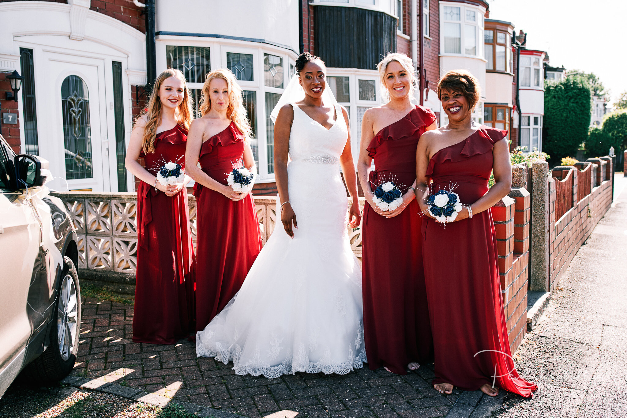 Bride and bridesmaids setting off for the wedding. Wedding Photographer Hull