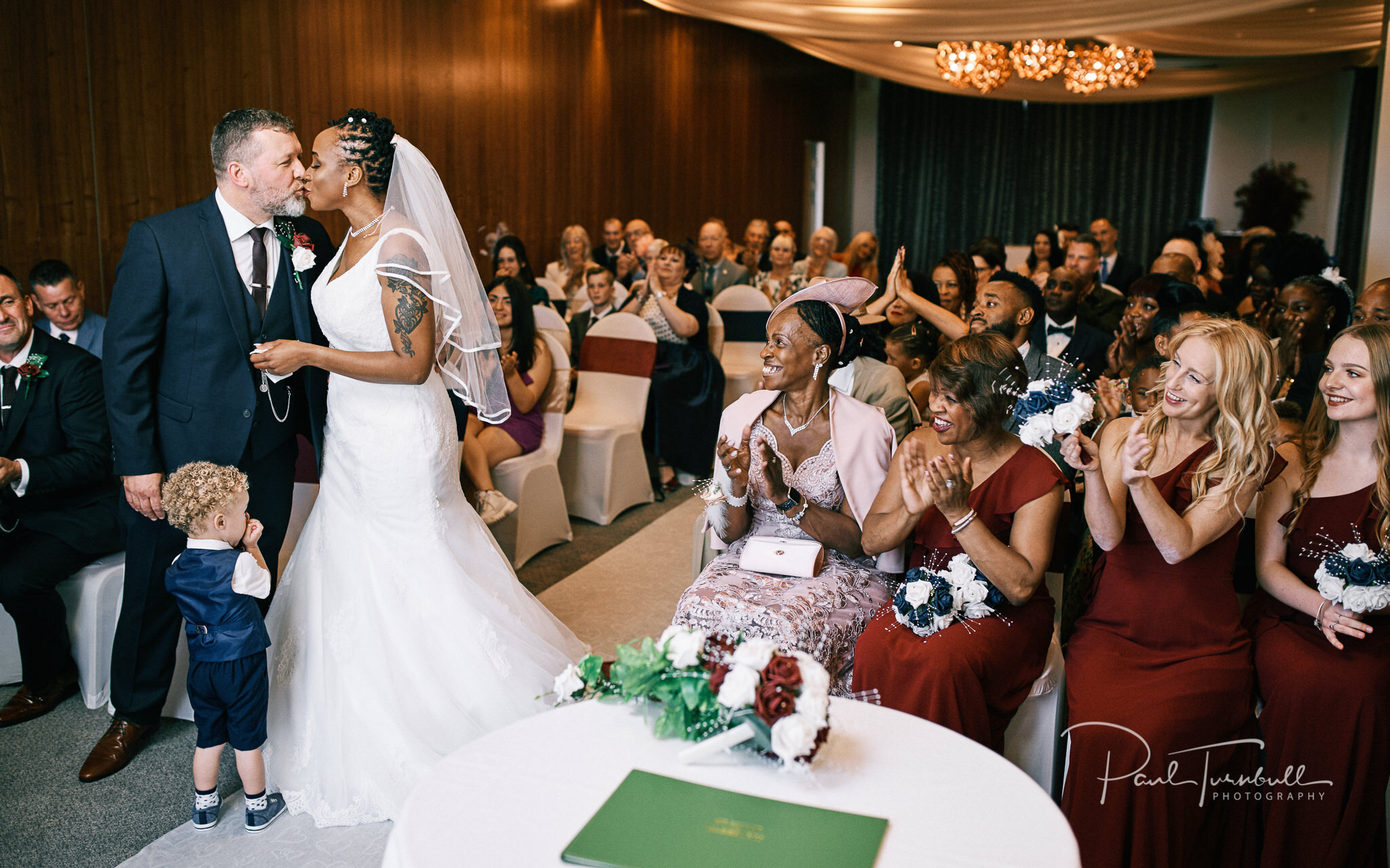 The first kiss at their Lazaat Hotel wedding. Wedding photographer Hull