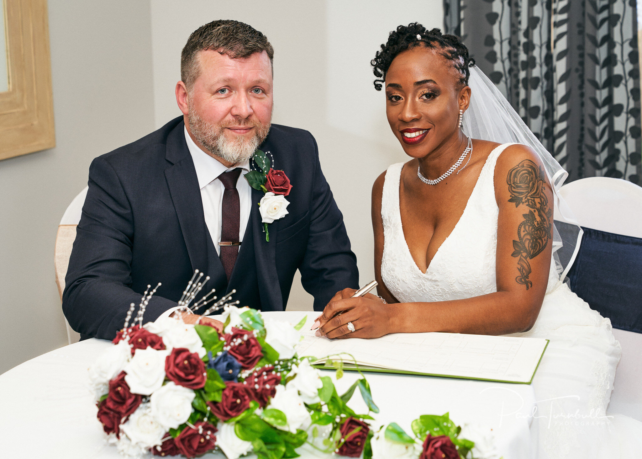 Bride and groom signing the register at Lazaat Hotel. Wedding photographer Hull