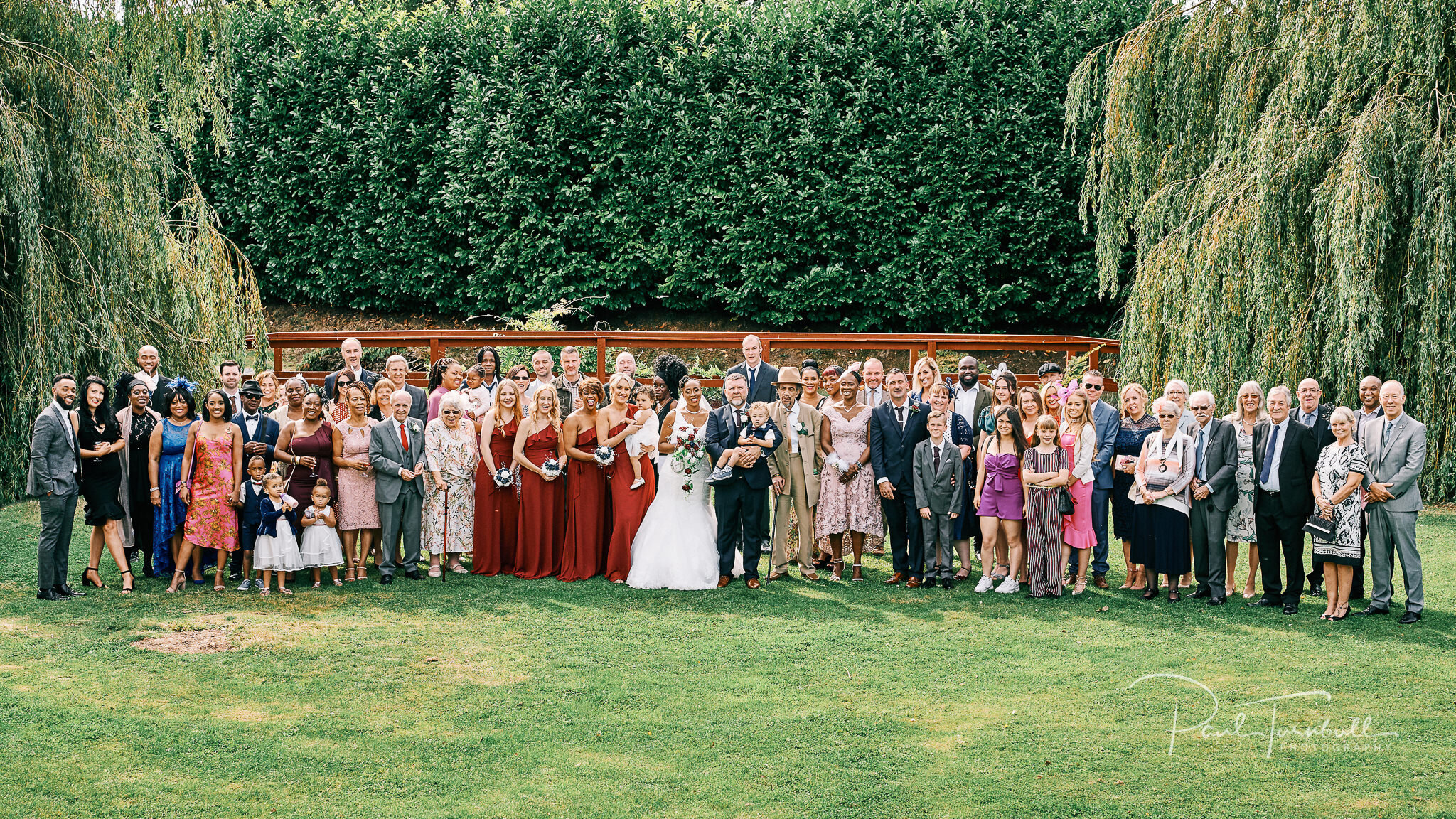 The full group shot outside Lazaat Hotel. Wedding photographer Hull