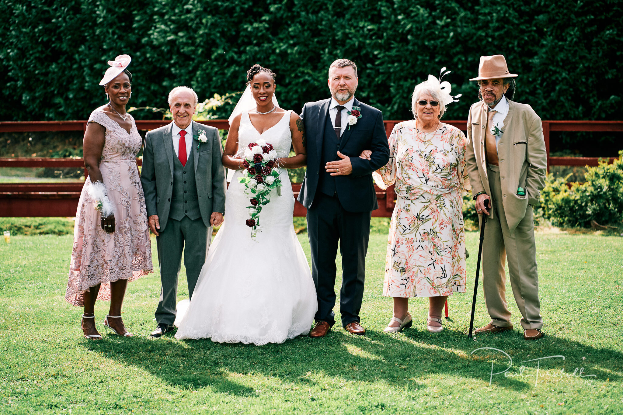 Bride and groom with their parents outside Lazaat Hotel. Wedding photographer Hull