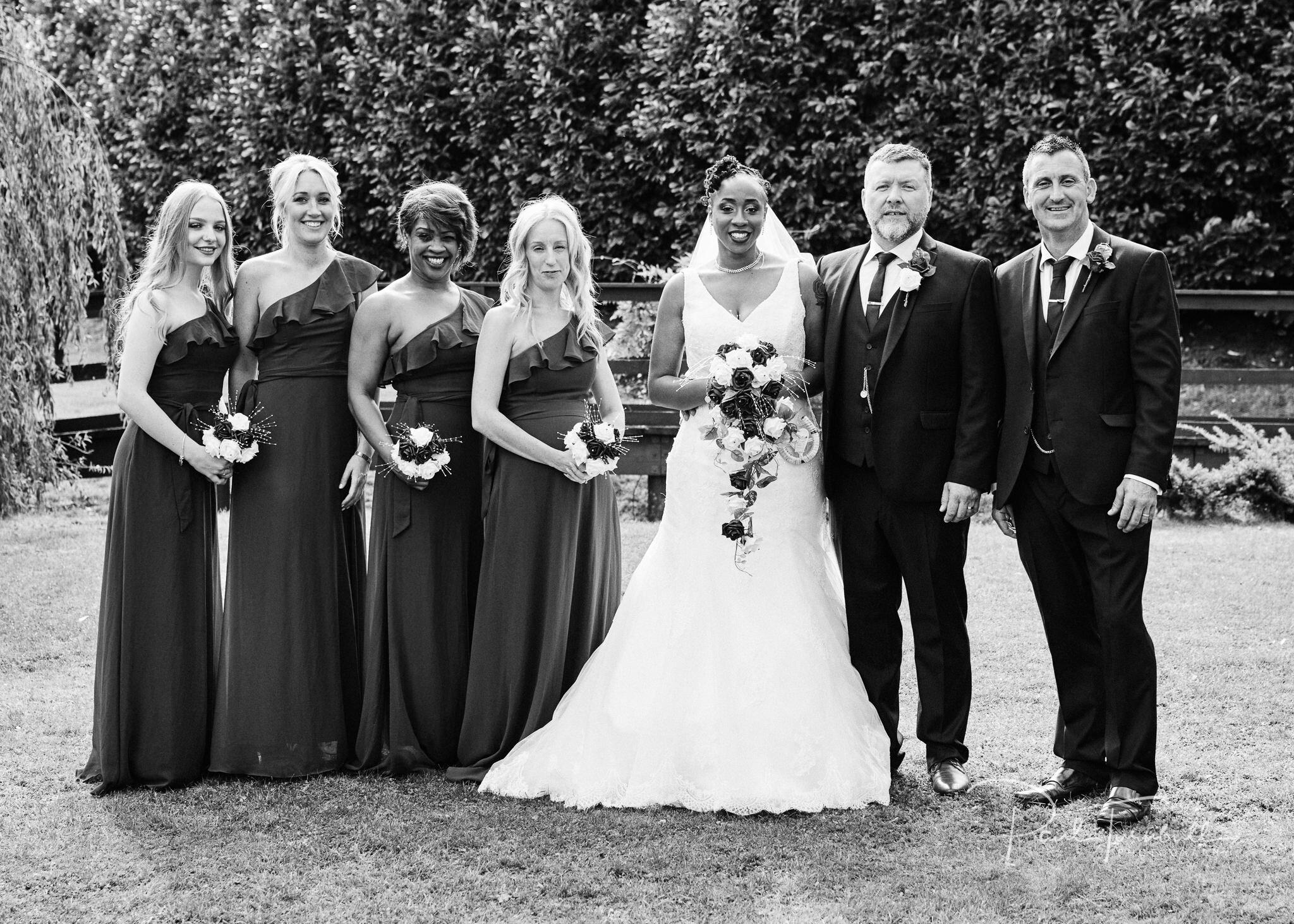 Bride, groom, bridesmaids and best man posing outside Lazaat. Wedding photographer Hull