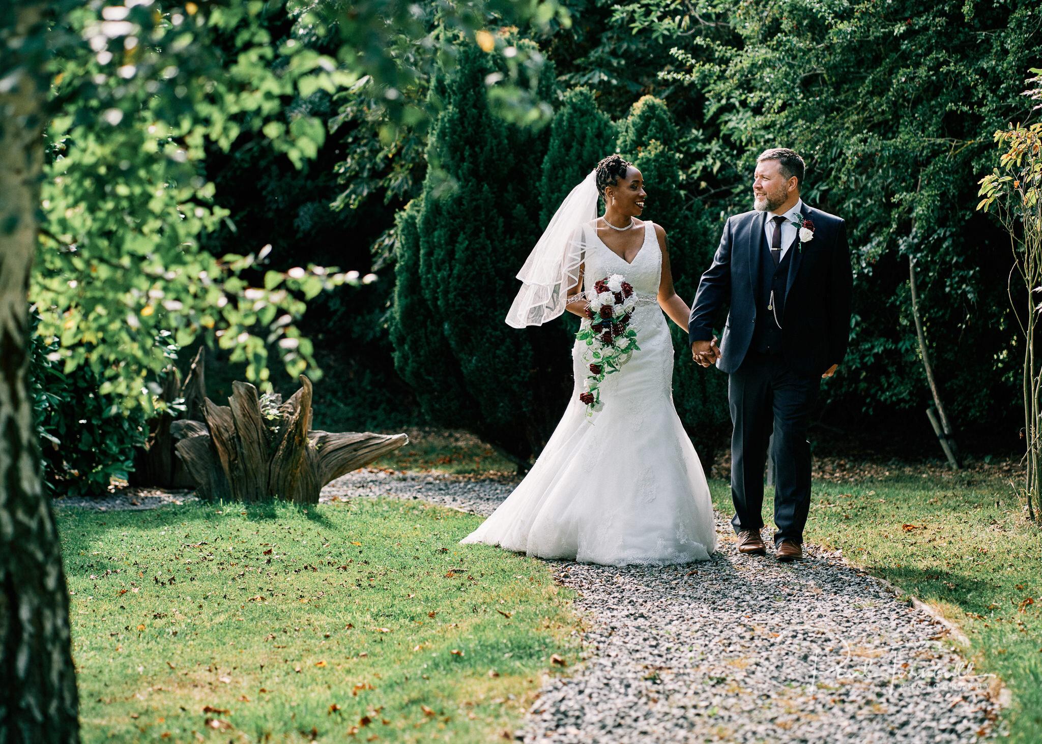 Bride and groom enjoying the gardens of Lazaat Hotel. Wedding photographer Hull