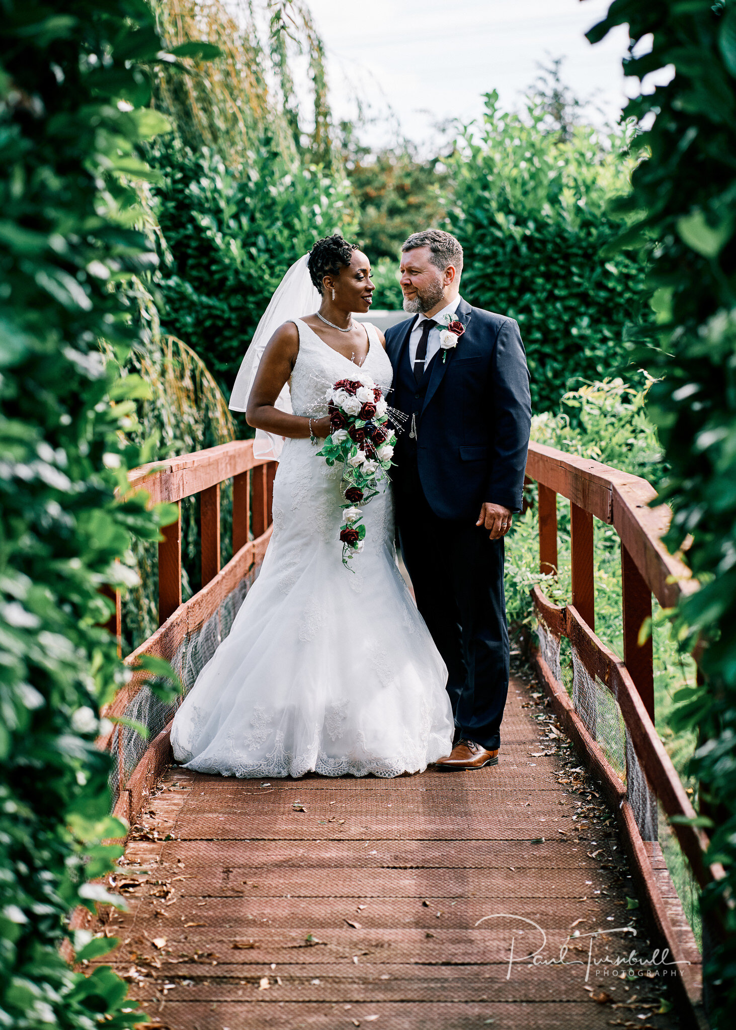 Bride and groom on the bridge in the gardens of Lazaat Hotel. Wedding photographer Hull