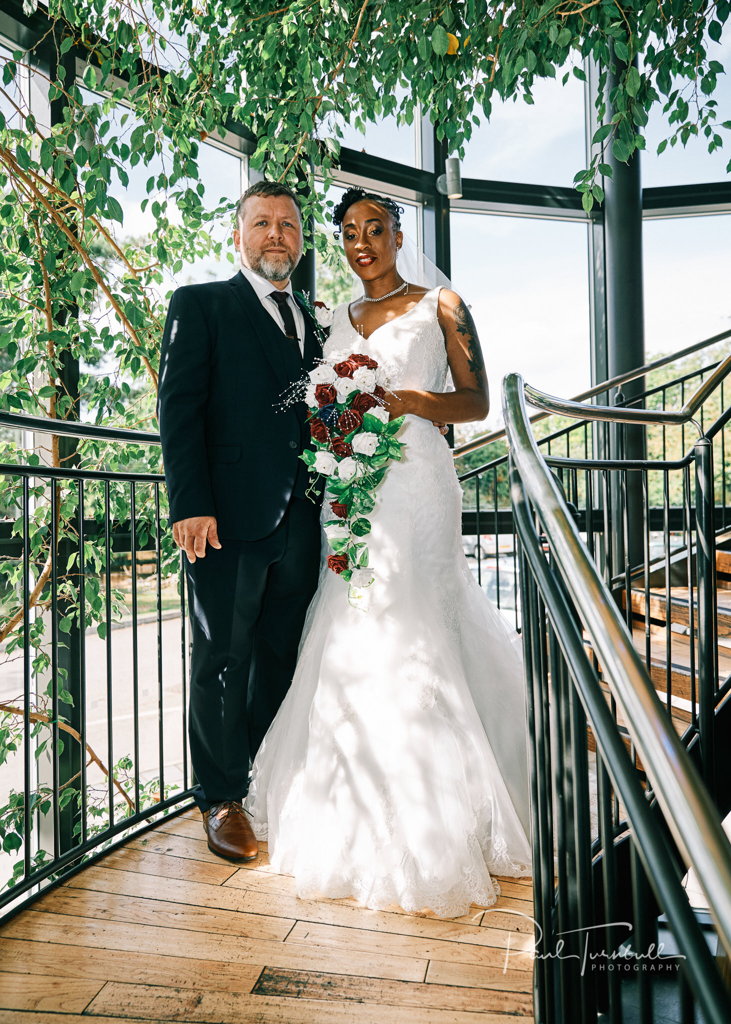 Bride and groom on the staircase at Lazaat Hotel. Bride and groom enjoying the gardens of Lazaat Hotel. Wedding photographer Hull