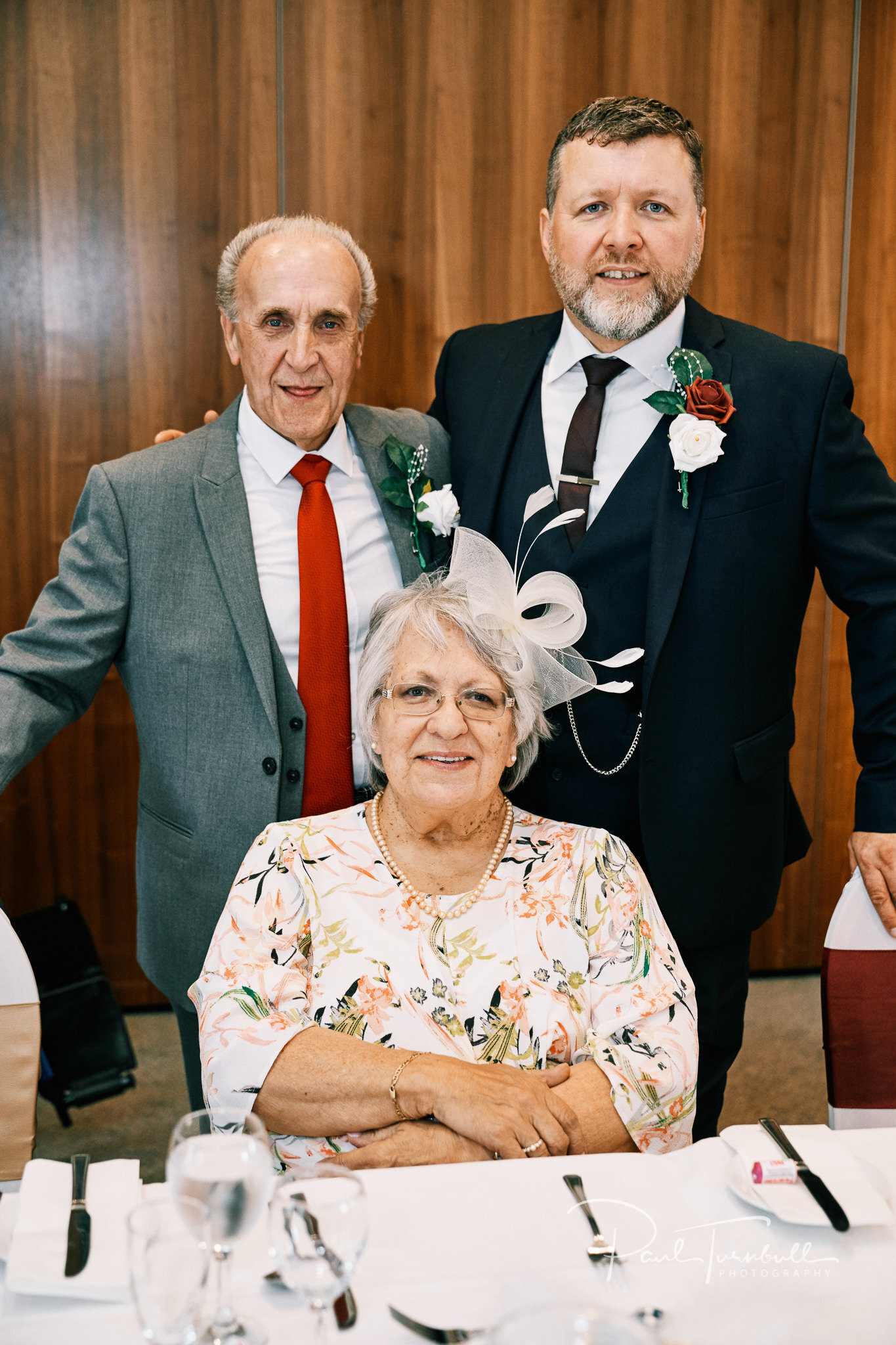 The groom with his parents. Bride and groom enjoying the gardens of Lazaat Hotel. Wedding photographer Hull