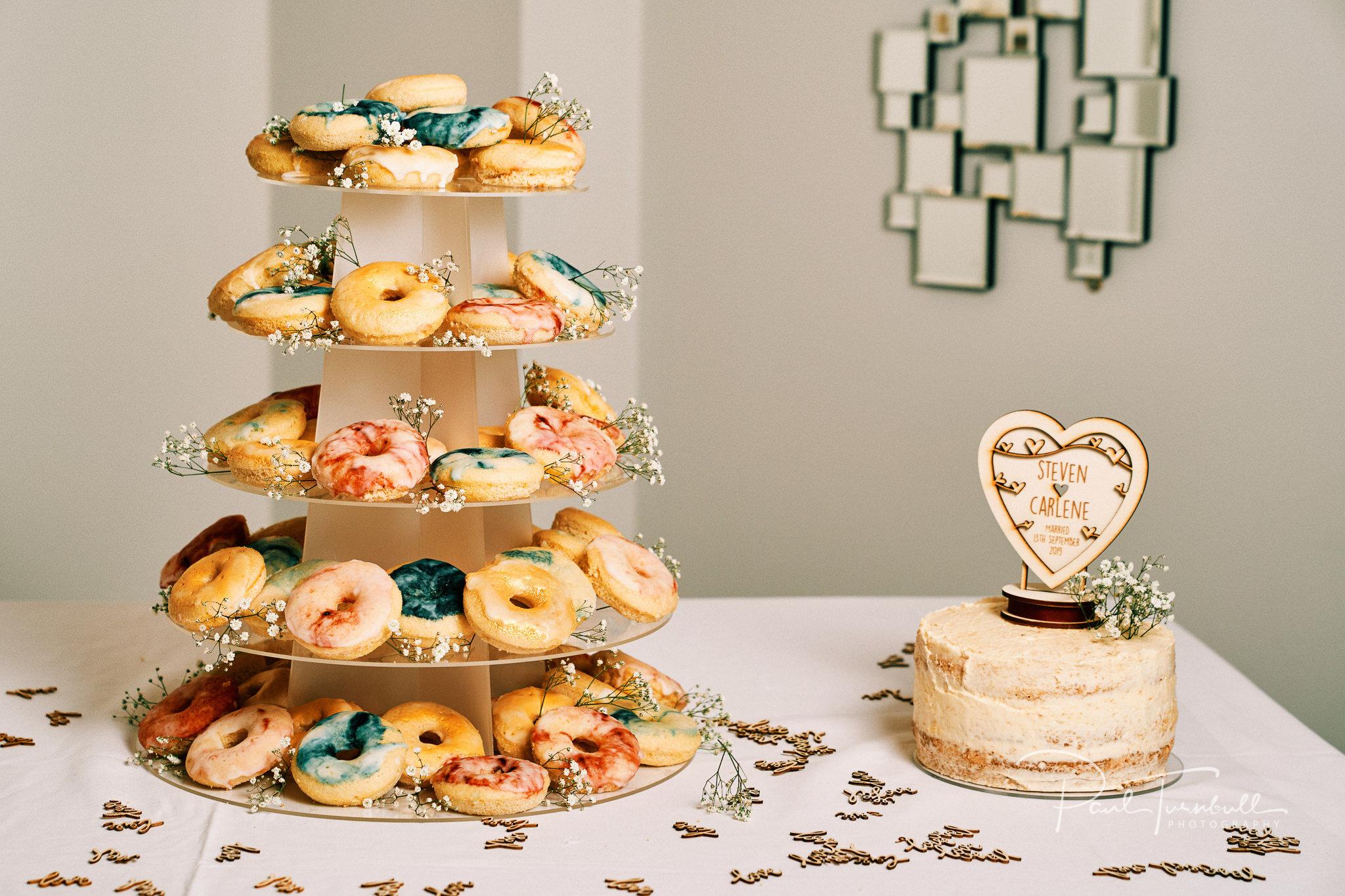 Doughnut tower and wedding cake at Lazaat Hotel. Bride and groom enjoying the gardens of Lazaat Hotel. Wedding photographer Hull